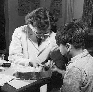Nurse takes blood sample of student at Indian School in Port Alberni during nutrition experiments (1940s) - Library and Archives Canada